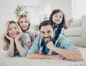 Happy family in living room of their home.